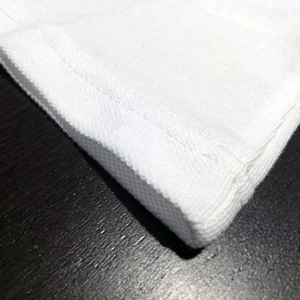 dettaglio bordo inferiore cucitura polo scuola femmina
